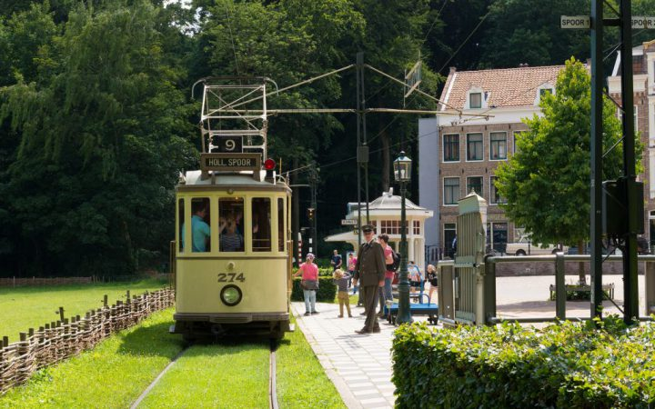 ARNHEM NETHERLANDS - JULY 26 2015: Unknown people waiting for an antique tram in the Netherlands Open Air museum. The museum shows the Dutch history from an everyday perspective