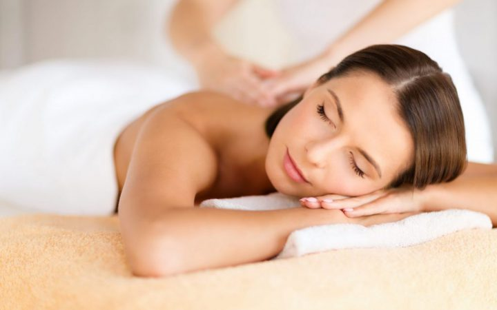 health, beauty, resort and relaxation concept - beautiful woman